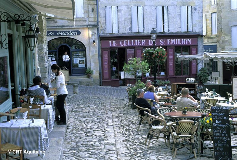Outdoor cafés in the cobbled St Emilion's Place de l'Eglise Monolithe