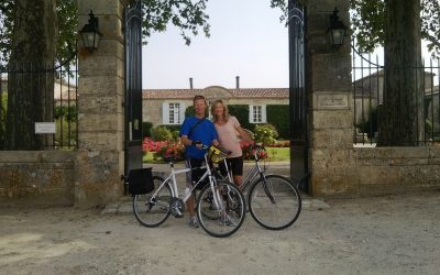 Chateau d'Arche entrance with cycling couple